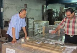Six companies will participate in the expo. Photo: Pallets of furniture loaded onto trucks